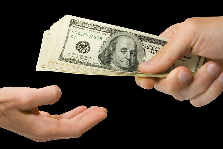 business and finance concept. money in hand isolated on the black