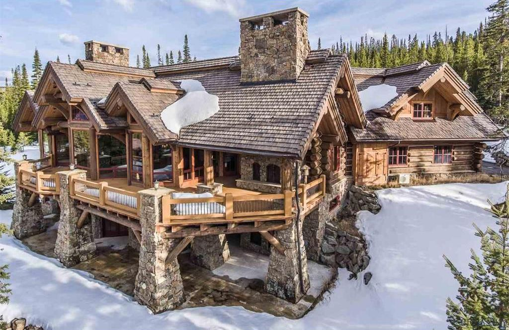 8 of the most stunning log cabin homes in america for Cabin builders montana
