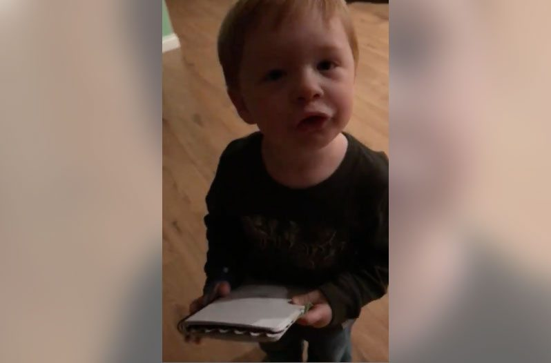 adorable southern boy helps mom make the grocery list